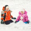 Boy and girl playing on the snow — Stock Photo