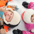 Stok fotoğraf: Boy and girl lying on snow