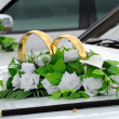 Beautiful floral decoration is on a wedding car — Stock Photo