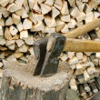 Royalty-Free Stock Photo: Old splitting axe on the background of woodpile