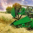 Stock Photo: Combine harvester working on field