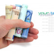 Euro banknotes in a hand on white background — Stock Photo