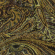 An exotic brown color pattern weaved fabric as textural backgrou - Стоковая фотография