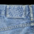 Blank leather jeans label sewed on a blue jeans - Stock Photo