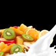 Splashing milk with fruit mix — Stock Photo