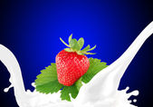 Splashing milk with strawberry — Stock Photo