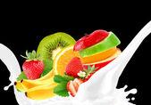 Splashing milk with fruit mix — Stock Photo