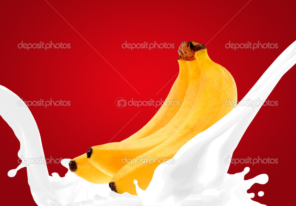 Splashing milk with banana  Stock Photo #7589938