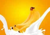 Splashing milk with banana — Stock Photo