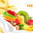 Milk splash with fruit mix on corn flakes background — Stock Photo #7687660