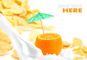 Milk splash with orange on corn flakes background — Stock Photo