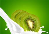 Splashing milk with kiwi — Stock Photo