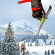 Snowboarder jumping through air with deep blue sky in background — Stock Photo #7925133