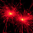 Red christmas sparkler - Stock Photo