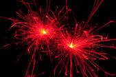 Red christmas sparkler — Stock Photo