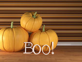 Three pumpkin on the floor with boo letters — Stock Photo