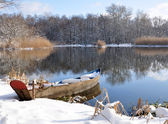 Winter Landscape with a fishing boat — Stock Photo