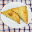 Royalty-Free Stock Photo: Two traditional South African Samoosa triangles filled with chic