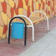 Stock Photo: Bench with urn