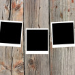Royalty-Free Stock Photo: Set of three old blank polaroids frames lying on a wood surface