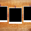 Set of three old blank polaroids frames lying on a wood surface — Stock Photo