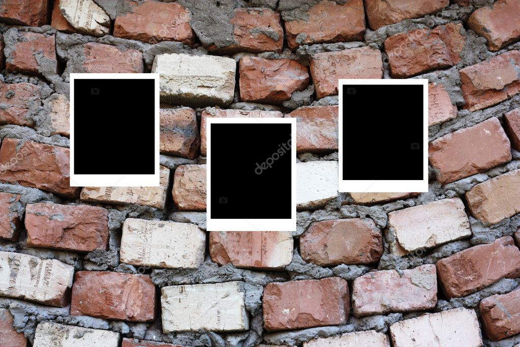 Set of three old blank polaroids frames lying on a brick surface  — Stock Photo #6867965