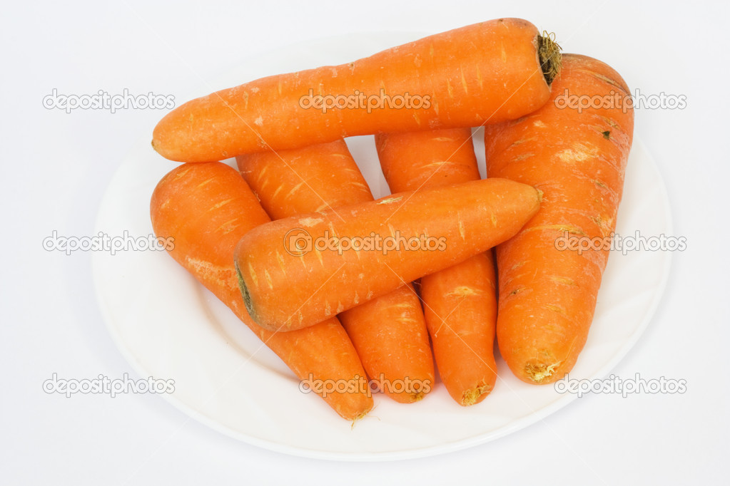 Ripe fresh carrots on a white background.   Stock Photo #6869230