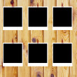 Set of ten old blank polaroids frames lying on a wood surface — Stock Photo