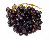 Bunch of black grapes isolated on white background — Stock Photo