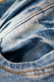 Closeup of blue jeans texture with stitch detail — Stock Photo