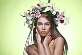 Beautiful woman with flower wreath. — Stock Photo