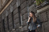 Happy young lady talking on mobile phone — Stock Photo
