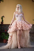 Blond beautiful luxury woman in wedding dress — Stock Photo