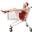Christmas woman in santa hat sitting in shopping cart over white — Stock Photo #7927842