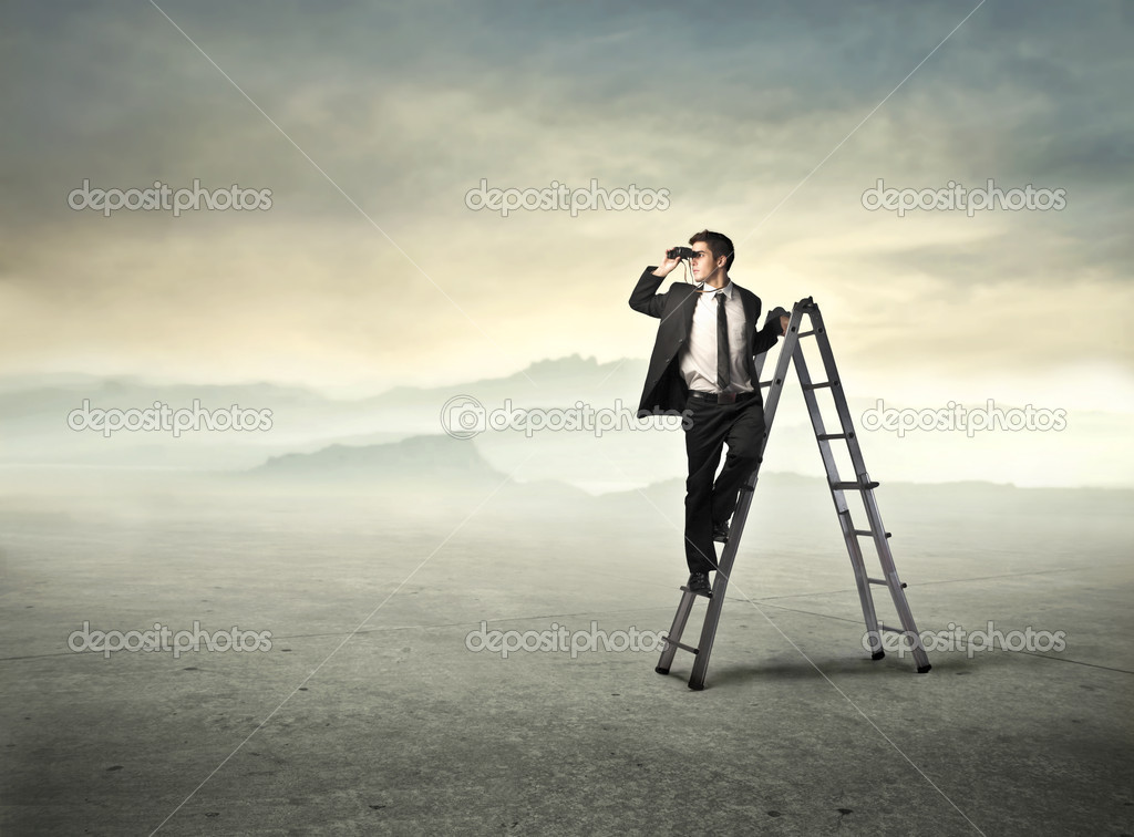 Businessman standing on a ladder and using binoculars — Stock Photo #7260923
