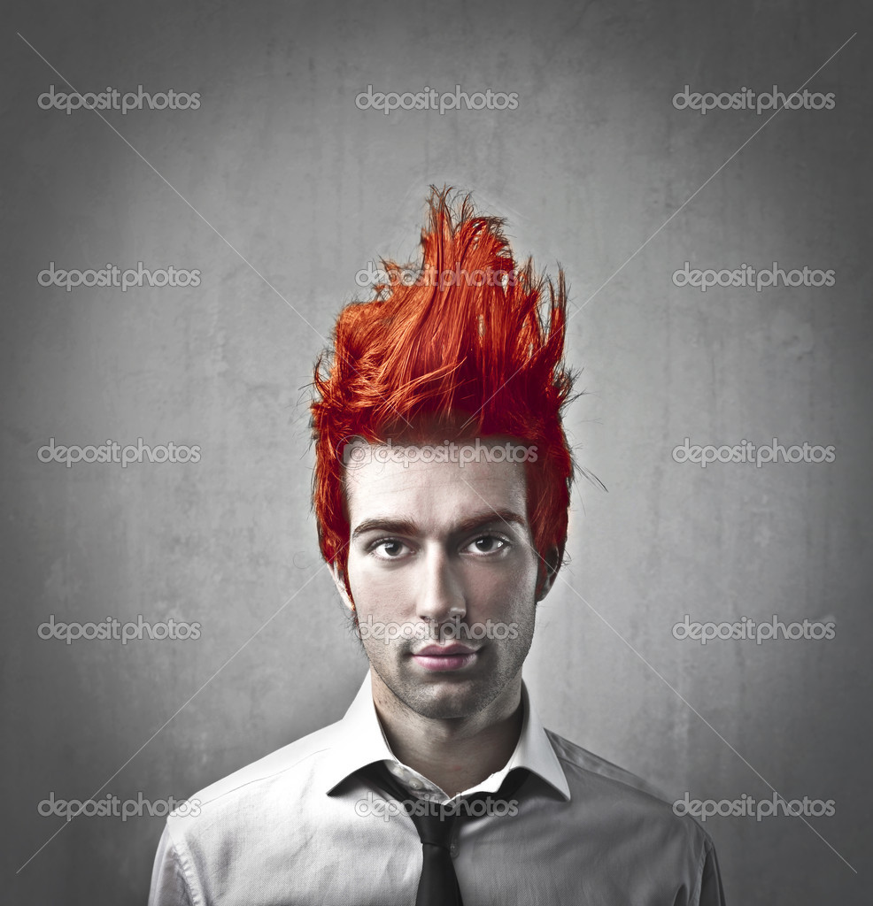 Young businessman with red upright hair — Stock Photo #7262170