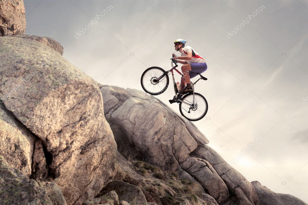 Cyclist riding a mountain bike on some rocks — Stock Photo #7263773