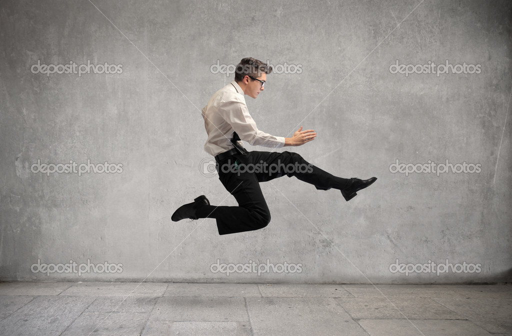 Young businessman running fast  Stock Photo #7626881