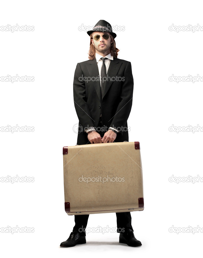 Handsome elegant man carrying a suitcase  Stock Photo #7627576