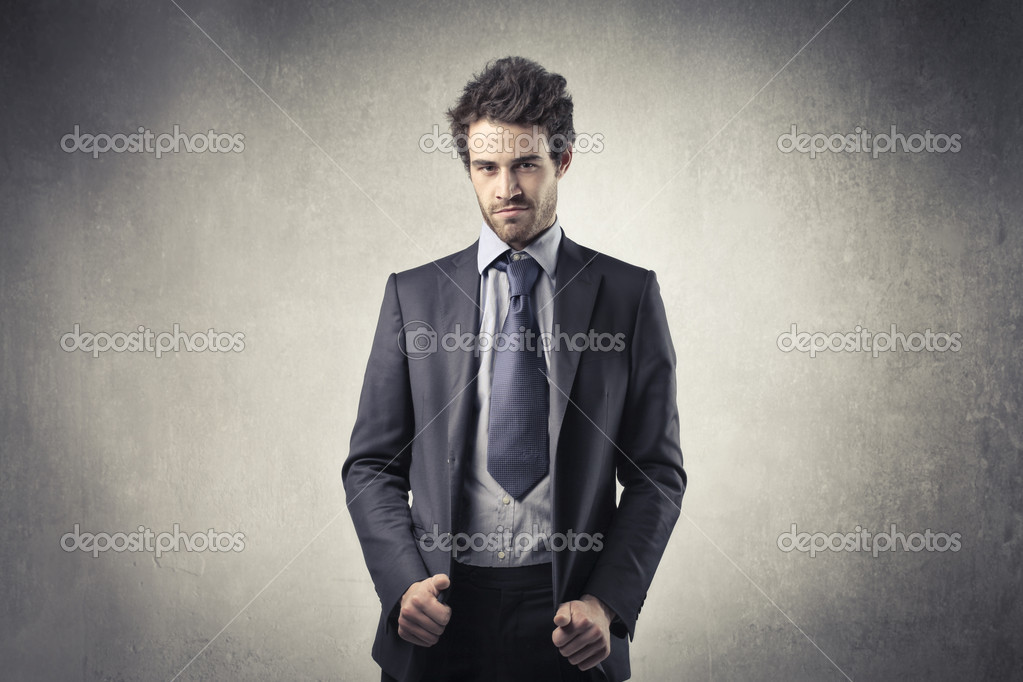 Portrait of a young handsome businessman  Stock Photo #7627687