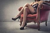 Closeup of a beautiful woman's legs wearing stiletto heels — Stock Photo