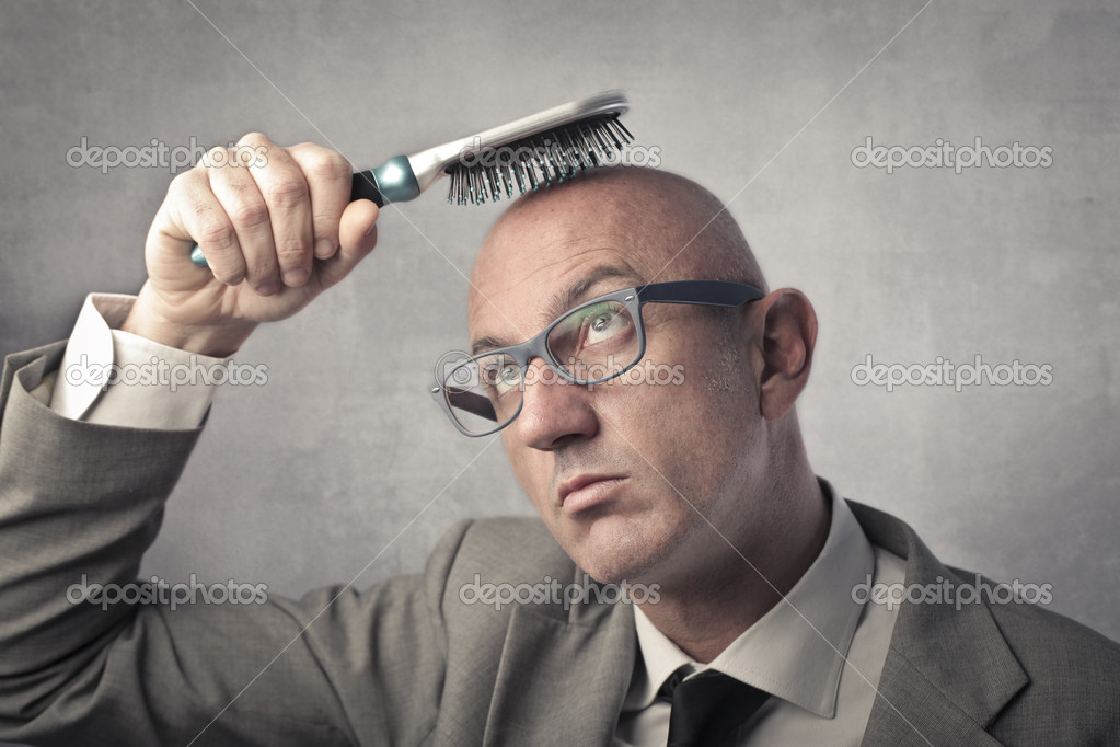 Bald businessman try to brush his head — Stock Photo #7864852