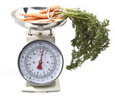 Old style kitchen scales with carrots on white background Isolat — Stock Photo