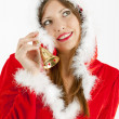 Portrait of female Santa Claus with a bell — Stock Photo