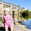Little girl sitting at railway viaduct in Douro Valley, Portugal — Stock Photo