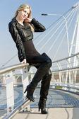 Woman wearing fashionable black boots — Stock Photo