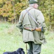 Hunter with his dog hunting — Stock Photo #6846041