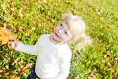 Portrait of little girl in autumnal nature — Stock Photo