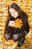 Woman in autumnal nature — Stock Photo