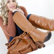 Woman wearing fashionable brown boots with a handbag — Стоковая фотография